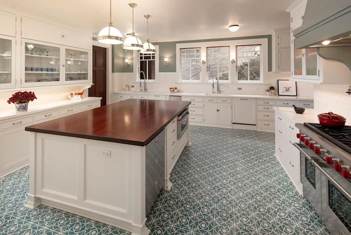 <p>While new appliances and modern surfaces have been installed, the look and feel of the original cabinetry and hardware have been retained.</p>