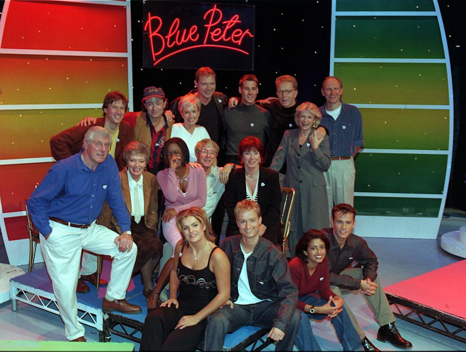 PA News 16/10/98 Past and present 'Blue Peter' presenters gathered to mark to programme's 40th anniversary: (back, from left) Peter Duncan, Christopher Wenner, Sarah Greene, John Leslie, Tim Vincent, Mark Curry, Tina Heath and Simon Groom; (middle, from left) Peter Purves, Leila Williams, Diane Louise Jordan, John Noakes and Valerie Singleton; (front, from left) Katy Hill, Stuart Miles, Konnie Huq and Richard Bacon. (Photo by Peter Jordan - PA Images/PA Images via Getty Images)