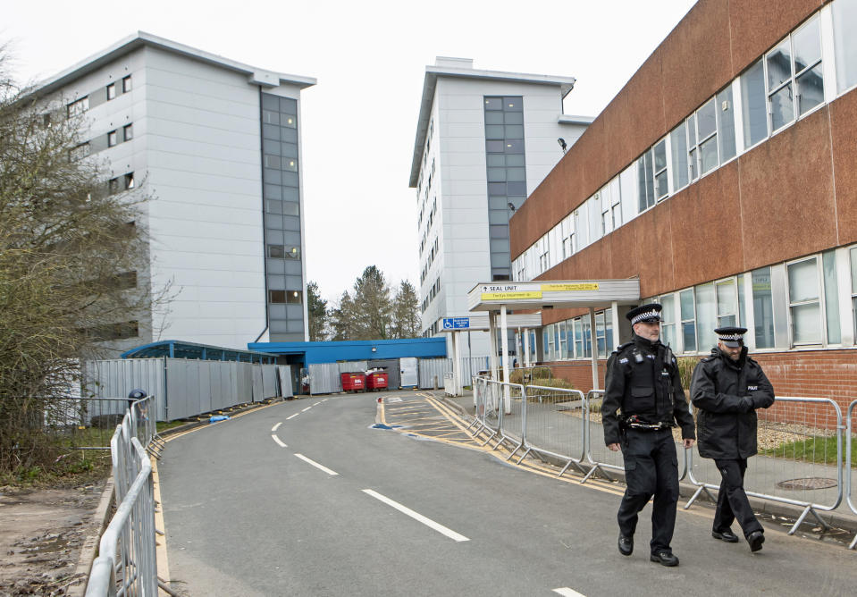 Police patrol outside the buildings at Arrowe Park Hospital, where passengers that have been repatriated to the UK from a cruise ship hit by the COVID-19 coronavirus in Yokohama, Japan, will be quarantined for 14 days to protect against the spread of the illness should any of them be infected, in Upton, England, Saturday Feb. 22, 2020.  The Diamond Princess cruise ship was stuck in quarantine off the coast of Yokohama, Japan, with 3,700 passengers and crew. (Danny Lawson/PA via AP)