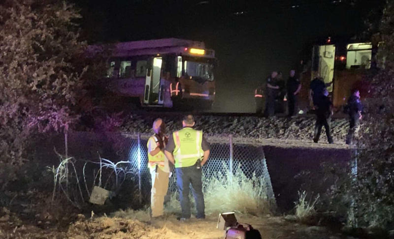 CORRECTS TO TAKE OUT REFERENCE OF DERAILMENT - In this image made from video, a Sacramento Regional Transit light-rail car is seen stopped in Sacramento, Calif., on Thursday, Aug. 22, 2019.   Authorities are investigating a crash that injured several people when Sacramento light rail commuter train struck a maintenance train. Sacramento Regional Transit spokeswoman Devra Selenis says Friday that the maintenance train was not moving when the crash happened late Thursday.  (Daniel Hunt/The Sacramento Bee via AP)