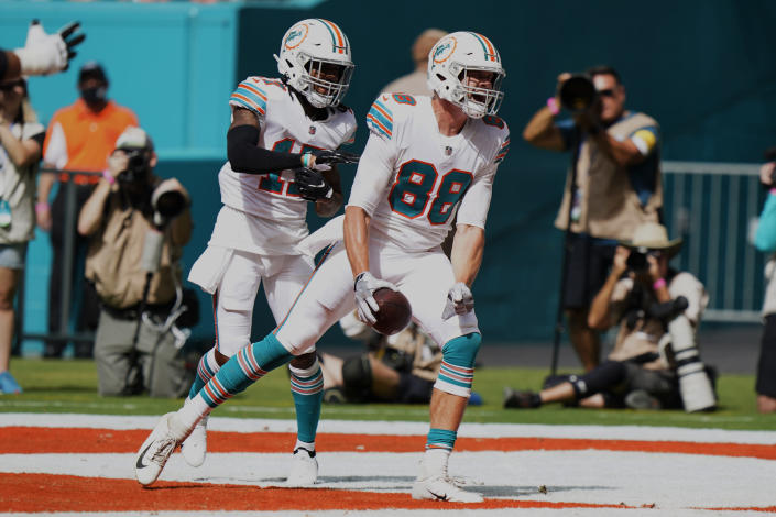 Miami Dolphins tight end Mike Gesicki (88) celebrates his touchdown with wide receiver Jaylen Waddle (17) during the second half of an NFL football game against the Indianapolis Colts Sunday, Oct. 3, 2021, in Miami Gardens, Fla. (AP Photo/WIlfredo Lee)