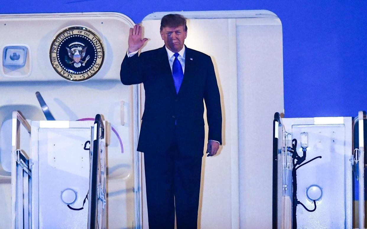 Trump arrived on Air Force One after flying half way around the world from Washington - AFP