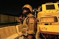 Perilous job: A Kenyan policeman with the African Union's peacekeeping mission in Somalia (AMISOM), on night patrol in Mogadishu