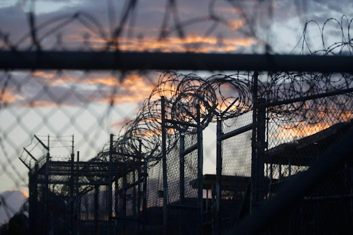 In this Nov. 21, 2013, file photo reviewed by the U.S. military, dawn arrives at the now closed Camp X-Ray, which was used as the first detention facility for al-Qaida and Taliban militants who were captured after the Sept. 11 attacks at Guantanamo Bay Naval Base, Cuba.