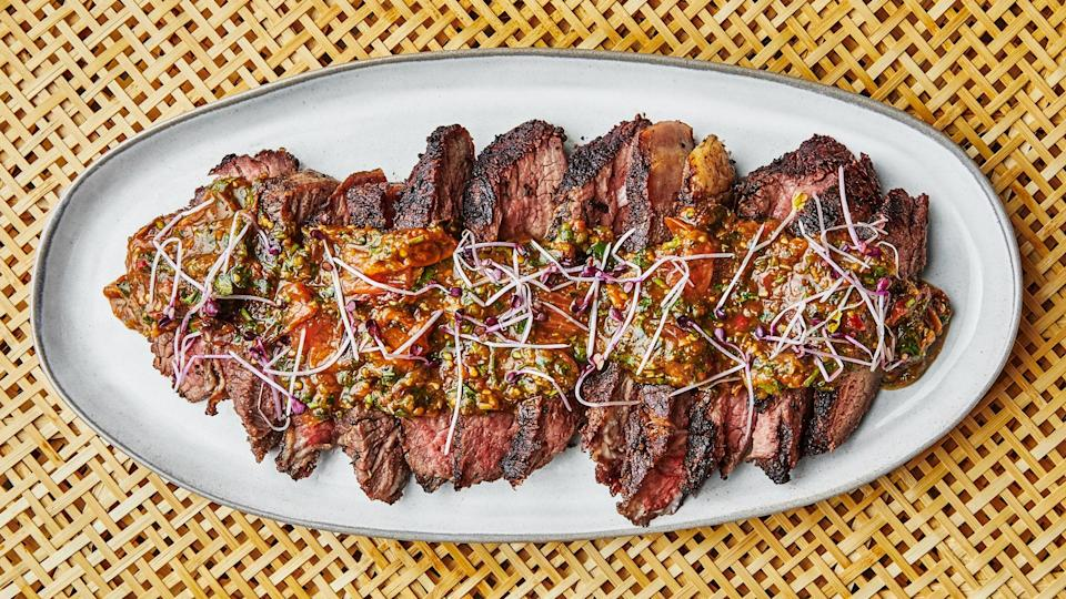 """Tiger bite sauce lives up to its name: it's spicy and deep in umami. Make a double batch and use it throughout the week because you're going to want extra. This recipe is from <a href=""""https://unionkitchenmn.com/"""" rel=""""nofollow noopener"""" target=""""_blank"""" data-ylk=""""slk:Union Hmong Kitchen"""" class=""""link rapid-noclick-resp"""">Union Hmong Kitchen</a> in Minneapolis, where chef Yia Vang works his wood-fired magic. <a href=""""https://www.bonappetit.com/recipe/tri-tip-steak-with-tiger-bite-sauce?mbid=synd_yahoo_rss"""" rel=""""nofollow noopener"""" target=""""_blank"""" data-ylk=""""slk:See recipe."""" class=""""link rapid-noclick-resp"""">See recipe.</a>"""