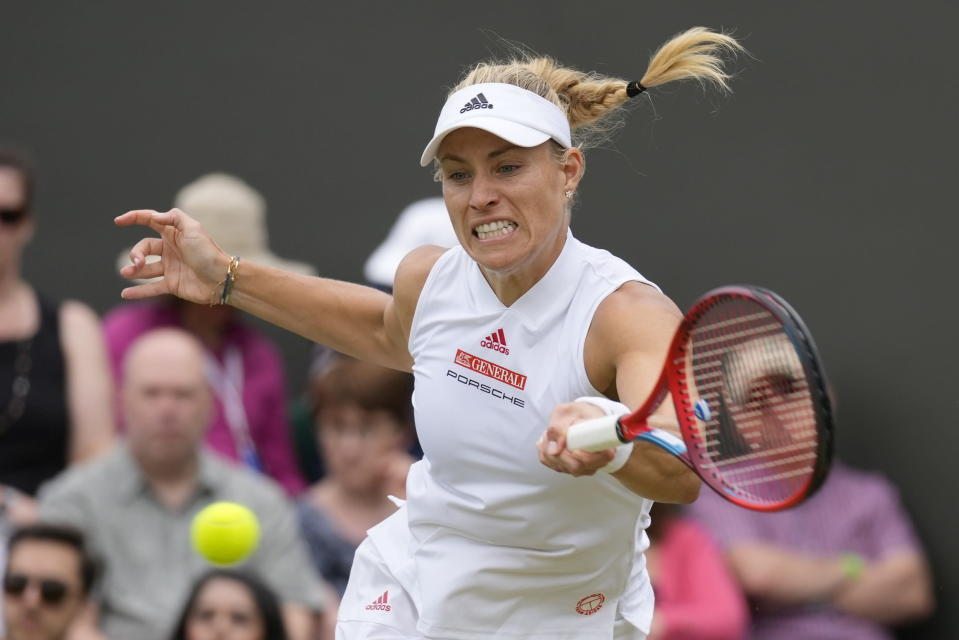 Germany's Angelique Kerber plays a return to Aliaksandra Sasnovich of Belarus during the women's singles third round match on day six of the Wimbledon Tennis Championships in London, Saturday July 3, 2021. (AP Photo/Kirsty Wigglesworth)