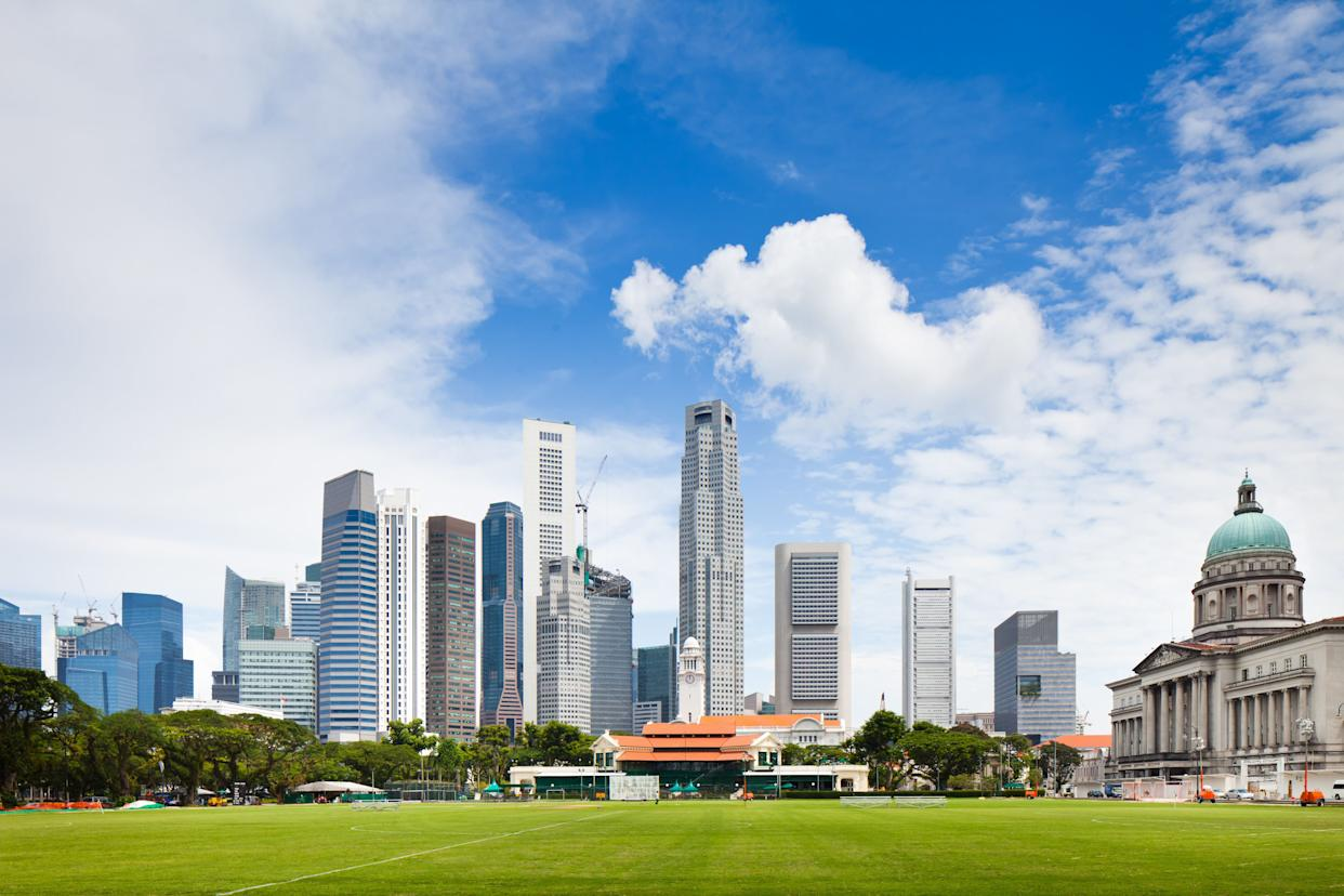 Astrid's husband, Michael, recalls playing soccer every week as a teenager at the Padang, an open field in Singapore's downtown historical center.