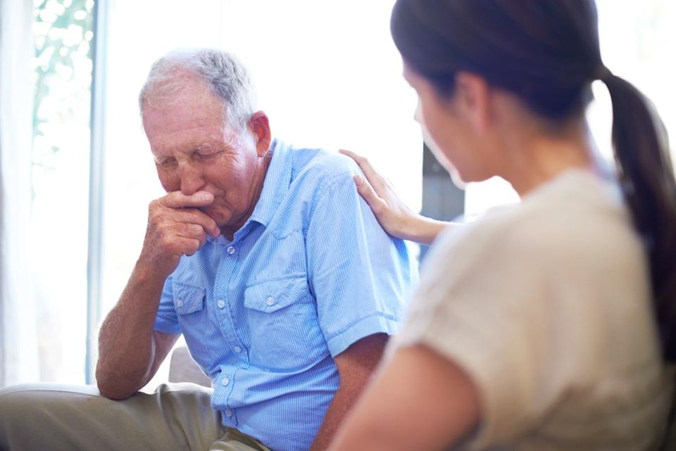 A devastated senior man dealing with some terrible news