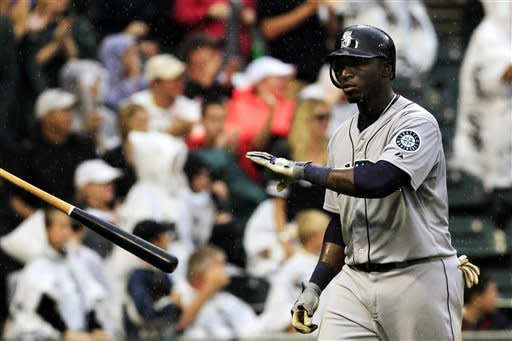 Seattle Mariners' Trayvon Robinson throws his bat after striking out with bases loaded during the seventh inning of a baseball game against the Chicago White Sox, Sunday, Aug. 26, 2012, in Chicago. (AP Photo/John Smierciak)