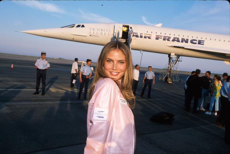 Heidi Klum in front of a Concorde jet after arriving for the 2000 Victoria's Secret Fashion Show and charity gala for amfAR during the Cannes Film Festival.