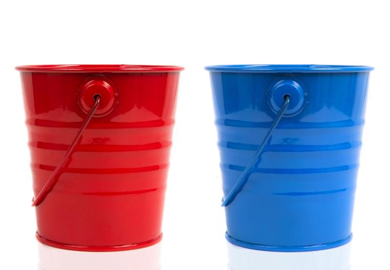 two buckets over white background