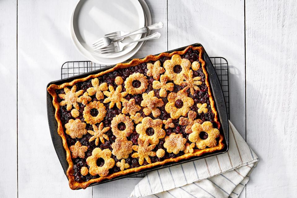 "<p><strong>Recipe: <a href=""https://www.southernliving.com/recipes/blueberry-orange-blossom-honey-slab-pie"" rel=""nofollow noopener"" target=""_blank"" data-ylk=""slk:Blueberry-Orange Blossom Honey Slab Pie"" class=""link rapid-noclick-resp"">Blueberry-Orange Blossom Honey Slab Pie</a></strong></p> <p>Have you ever seen a prettier pie that also feeds 12 people? We thought not. Orange, honey, and blueberry make the freshest trio of flavors. </p>"