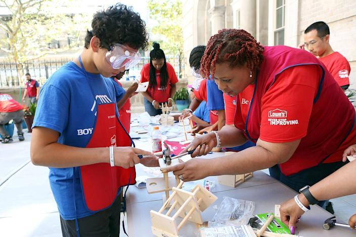 Lowe's Heroes volunteers join Boys & Girls Club of Harlem kids and teens to work on a club renovation in 2016 in New York. (Krista Kennell/AP Images for Boys & Girls Clubs of America)