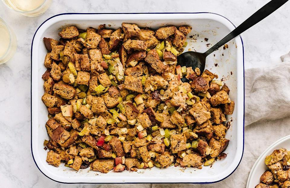 """<p>If you're trying to serve a few <a href=""""https://www.thedailymeal.com/cook/50-vegetarian-recipes-meatless-mondays-or-any-other-time-slideshow?referrer=yahoo&category=beauty_food&include_utm=1&utm_medium=referral&utm_source=yahoo&utm_campaign=feed"""" rel=""""nofollow noopener"""" target=""""_blank"""" data-ylk=""""slk:vegetarian-friendly recipes"""" class=""""link rapid-noclick-resp"""">vegetarian-friendly recipes</a> this Thanksgiving, stuffing is a great way to go. Simply use veggie stock instead of chicken stock.</p> <p><a href=""""https://www.thedailymeal.com/recipes/vegetarian-apple-cranberry-stuffing-recipe?referrer=yahoo&category=beauty_food&include_utm=1&utm_medium=referral&utm_source=yahoo&utm_campaign=feed"""" rel=""""nofollow noopener"""" target=""""_blank"""" data-ylk=""""slk:For the Vegetarian Apple Cranberry Stuffing recipe, click here."""" class=""""link rapid-noclick-resp"""">For the Vegetarian Apple Cranberry Stuffing recipe, click here.</a></p>"""