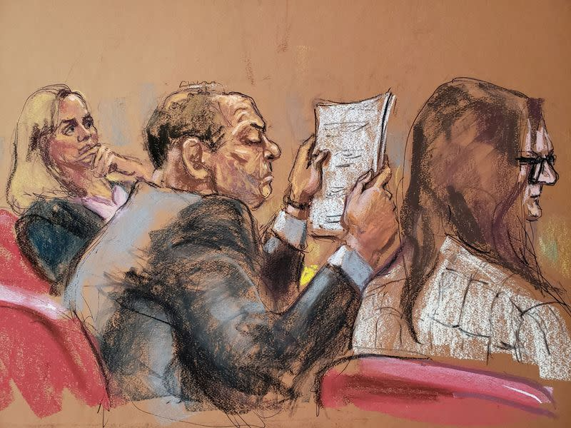 Harvey Weinstein sits at the defense table reading papers during jury deliberations in his sexual assault trial
