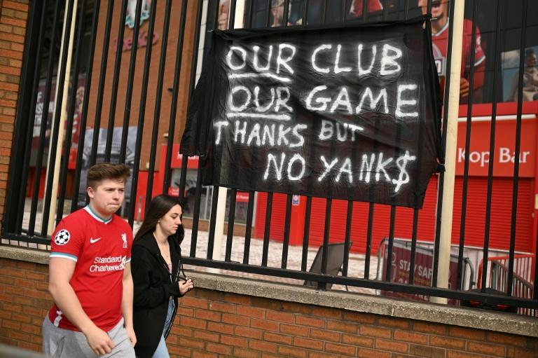 Supporters protest against Liverpool's US owners at Anfield