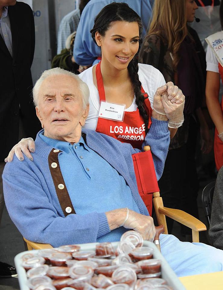 "Kim took a photo op with screen legend Kirk Douglas, who hosted the event along with his wife Anne for the seventh year in a row. ""Met so many kind hearted people!"" Kim tweeted of her experience. ""There goal is to feed 120,000 people by the end of the yr! We fed so many today."" (11/23/2011)"