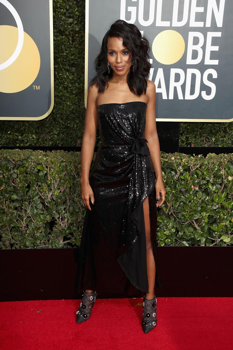 <p>Wearing a Prabal Gurung dress with Roger Vivier booties and Lorraine Schwartz jewels at the 2018 Globes. </p>