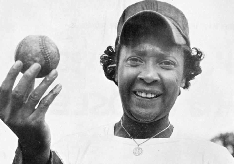 Portrait of American baseball player Toni Stone, of the Negro League's Indianapolis Clowns, as she poses with a baseball, Florida, spring 1953. Stone was the first woman to play professional baseball. (Photo by Transcendental Graphics/Getty Images)