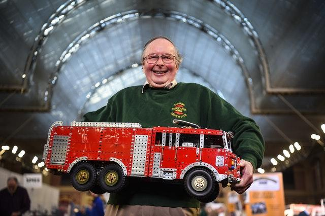 George Illingworth holds a model fire engine