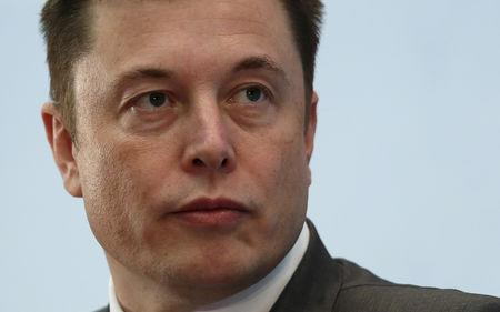 FILE PHOTO: Tesla Chief Executive Elon Musk attends a forum on startups in Hong Kong, China January 26, 2016. REUTERS/Bobby Yip/File Photo