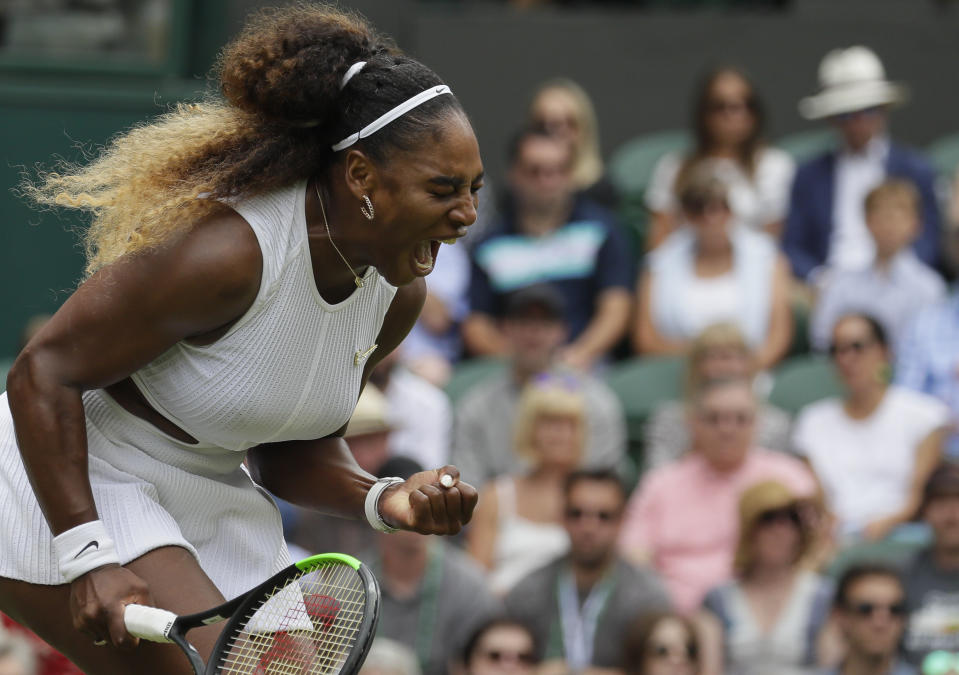 United States' Serena Williams celebrates after winning a point against United States' Alison Riske during a women's quarterfinal match on day eight of the Wimbledon Tennis Championships in London, Tuesday, July 9, 2019. (AP Photo/Kirsty Wigglesworth)
