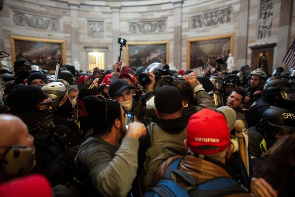 Trump supporters storming the US Capitol last WednesdayReuters