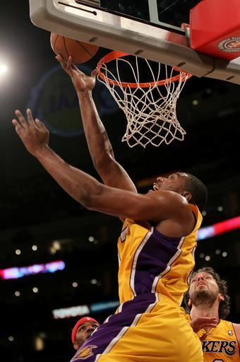 LOS ANGELES, CA - FEBRUARY 14: Andrew Bynum #17 of the Los Angeles Lakers shoots against the Atlanta Hawks at Staples Center on February 14, 2012 in Los Angeles, California. (Photo by Stephen Dunn/Getty Images)