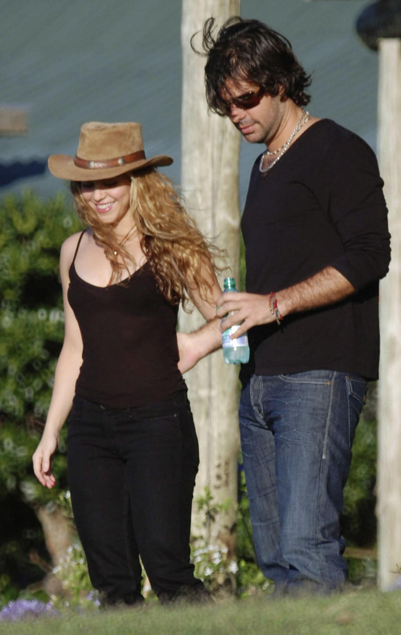 "FILE - In this Dec. 18, 2008 file photo, Colombian pop singer Shakira, left, walks with Antonio De La Rua at her farm ""La Colorada"" in Jose Ignacio, Uruguay. A judge in Geneva has rejected a request from Shakira's ex-boyfriend, De La Rua, seeking access to one of the singer's bank accounts. In documents dated June 17, 2013, and obtained by The Associated Press, the judge said Shakira is the account's sole owner. (AP Photo/File)"