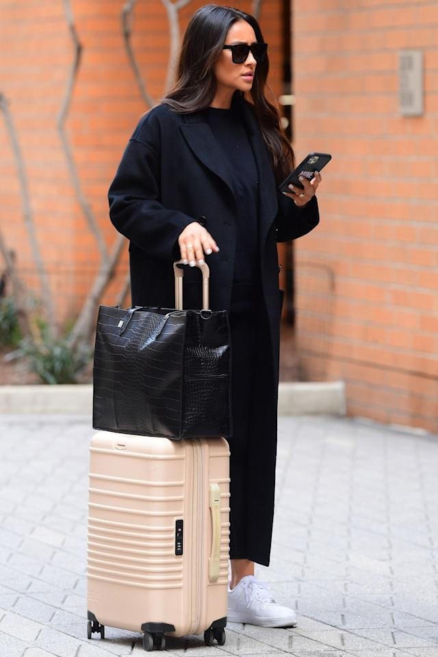 <p>Shay Mitchell looks stylish in all black as she heads to the airport in New York City on Friday.</p>