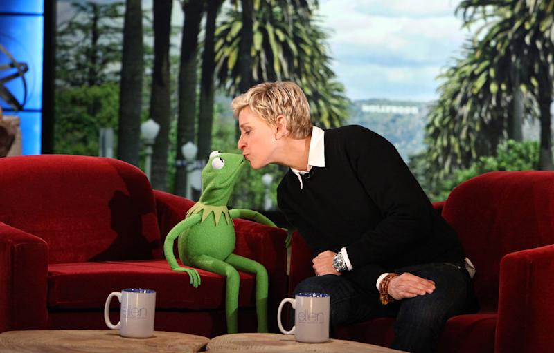 """FILE - In this Nov. 8, 2011 file photo provided by Warner Bros., talk show host Ellen DeGeneres kisses Kermit The Frog on """"The Ellen DeGeneres Show"""" in Burbank, Calif. Show producers and NBC announced Monday, March 11, 2013 that """"The Ellen DeGeneres Show"""" has been renewed through 2017. (AP Photo/Warner Bros. Television, Michael Rozman, File)"""
