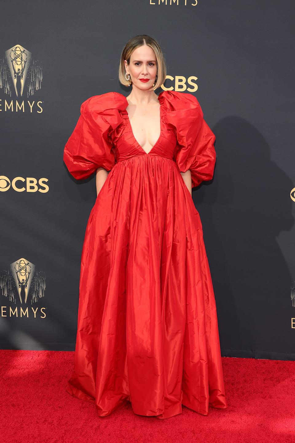 Sarah Paulson wears a red puff sleeve gown at the 73rd Primetime Emmy Awards at L.A. LIVE on September 19, 2021 in Los Angeles, California. (Photo by Rich Fury/Getty Images)