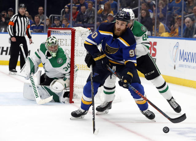 Dallas Stars goaltender Ben Bishop (30) watches as St. Louis Blues center Ryan O'Reilly (90) attempts to set up a shot during the second period in Game 7 of an NHL second-round hockey playoff series, Tuesday, May 7, 2019, in St. Louis. (AP Photo/Jeff Roberson)