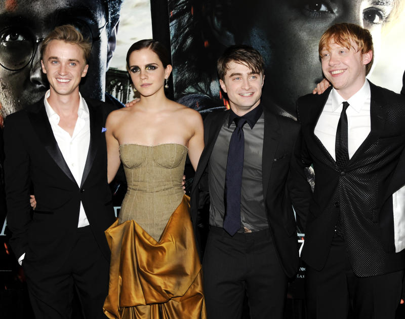 "harry potter cast members, from left, Tom Felton, Emma Watson, Daniel Radcliffe and Rupert Grint pose together at the premiere of ""Harry Potter and the Deathly Hallows: Part 2"" at Avery Fisher Hall in New York. The film is the eighth and final film in the Harry Potter series. (AP Photo/Evan Agostini, file)"