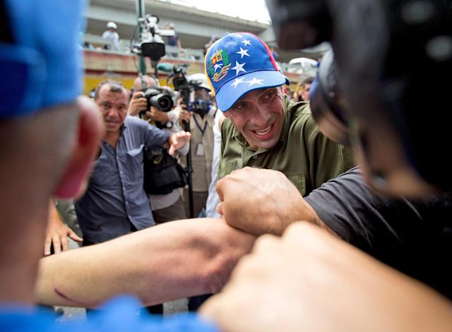<p>Opposition leader Henrique Capriles reacts is pepper-sprayed by Bolivarian National Police during a protest in Caracas, June 7, 2016. (AP/Fernando Llano) </p>