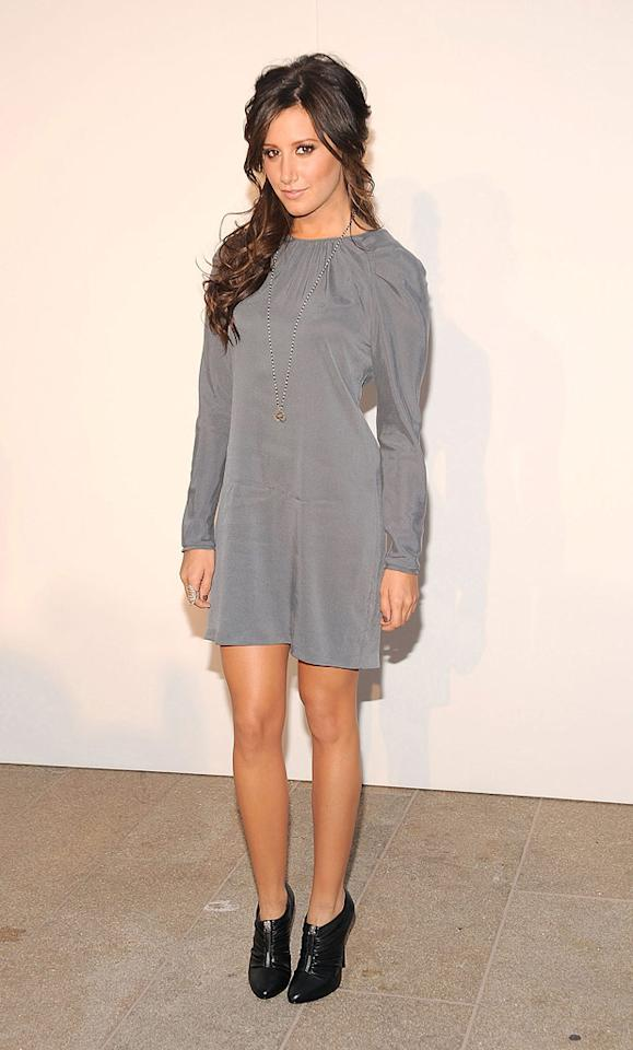 "Ashley Tisdale -- whose new show ""Hellcats"" debuts on The CW tonight -- opted for a long-sleeved gray smock and black booties at the glamorous event. Gary Gershoff/<a href=""http://www.wireimage.com"" target=""new"">WireImage.com</a> - September 7, 2010"