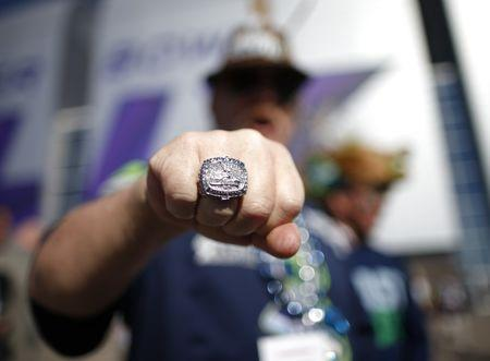 A Seattle Seahawks fan shows off a replica Super Bowl ring while awaiting the start of the NFL Super Bowl XLIX football game against the New England Patriots outside of the stadium in Glendale, Arizona February 1, 2015. REUTERS/Lucy Nicholson