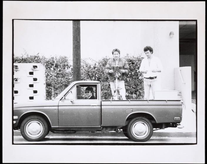 "Danny Kwan, left, Ed Ruscha and Bryan Heath in Ruscha's Datsun pickup truck in a 1975 image from the artist's ""Streets of Los Angeles"" archive. <span class=""copyright"">(Ed Ruscha / Getty Research Institute)</span>"