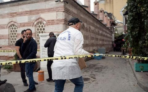Police forensic officials at the scene in Istanbul - Credit: Emrah Gurel/AP