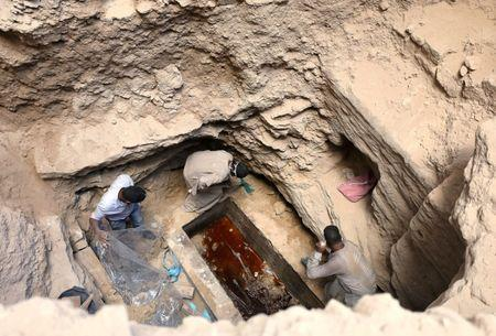 Archaeologists unearth coffin containing three mummies with sewage water and bones inside, in Alexandria, Egypt July 19, 2018. REUTERS/Mohamed Abd El Ghany