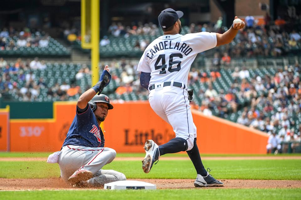 Luis Arraez #2 of the Minnesota Twins is out at third as Jeimer Candelario #46 of the Detroit Tigers throws to Jonathan Schoop #7 of the Detroit Tigers at first during the top of the third inning at Comerica Park on July 18, 2021 in Detroit, Michigan.