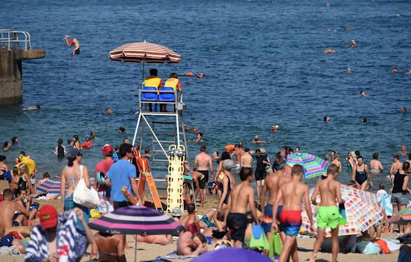 People sunbathe at the at the Port-Vieux beach in Biarritz, southwestern France, on July 30. Source: Getty