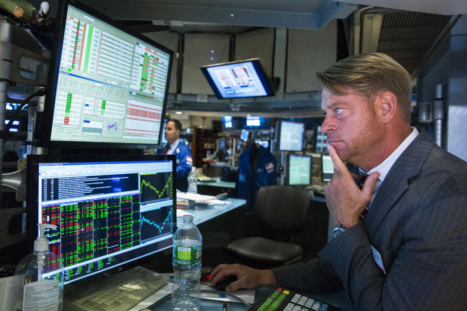 A trader watches the screen in his terminal on the floor of the New York Stock Exchange in New York October 15, 2014. (Photo: REUTERS/Lucas Jackson)