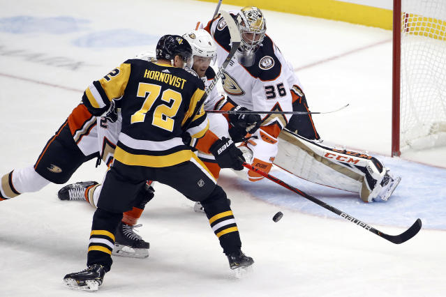Pittsburgh Penguins' Patric Hornqvist (72) cannot get his stick on the puck in front of Anaheim Ducks goaltender John Gibson (36) with Cam Fowler (4) defending during the first period of an NHL hockey game in Pittsburgh, Thursday, Oct. 10, 2019. (AP Photo/Gene J. Puskar)