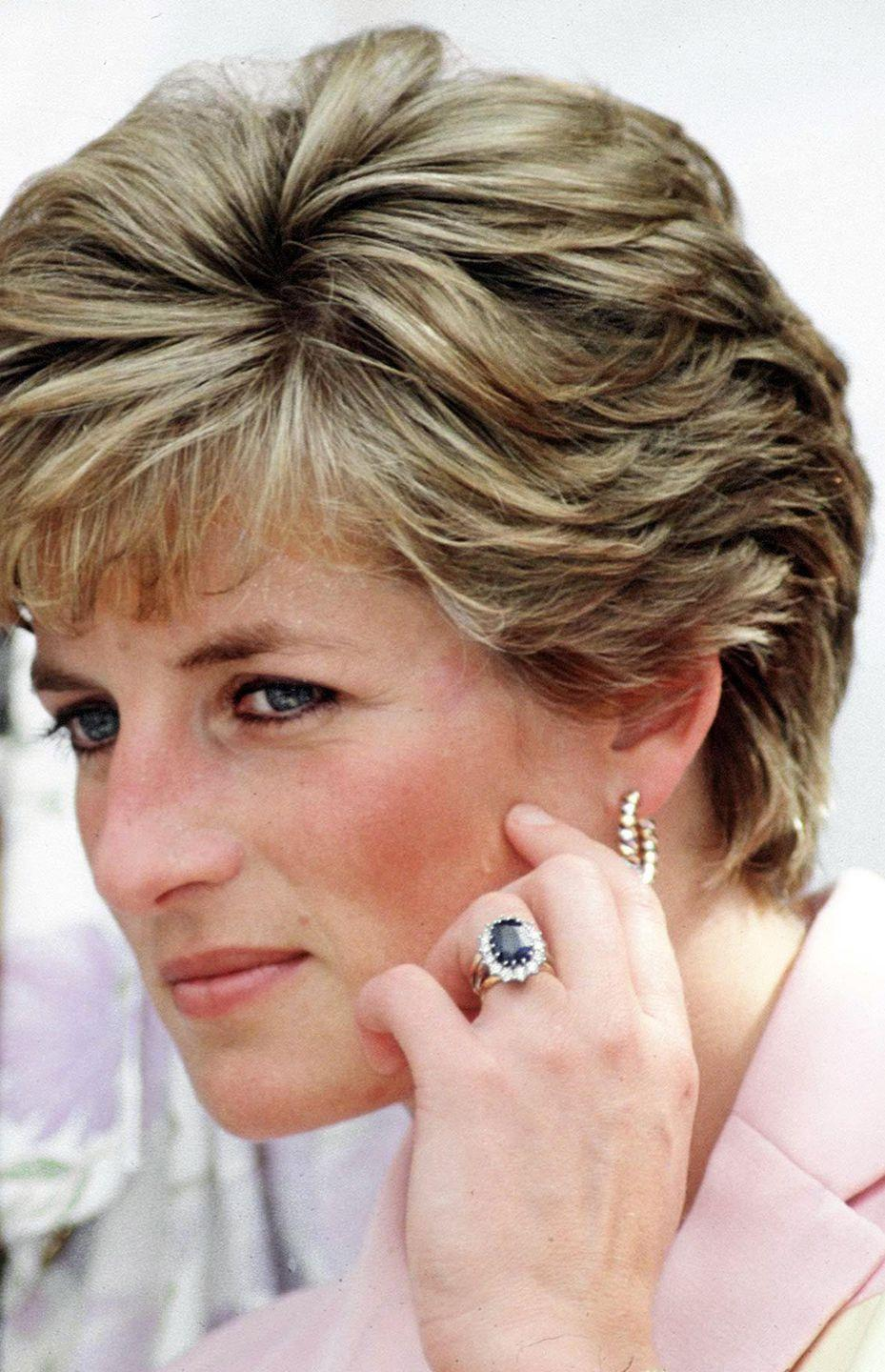 "<p>Although royal engagement rings are usually custom made, the 19-year-old bride selected hers from the <a href=""http://garrard.com/"" rel=""nofollow noopener"" target=""_blank"" data-ylk=""slk:Garrard"" class=""link rapid-noclick-resp"">Garrard</a> jewelry collection catalog. Now <a href=""http://www.today.com/id/40217151/ns/today-today_news/t/untold-stories-behind-kates--carat-sapphire/#.Vg7hFGTF_Yl"" rel=""nofollow noopener"" target=""_blank"" data-ylk=""slk:Duchess Kate Middleton wears"" class=""link rapid-noclick-resp"">Duchess Kate Middleton wears</a> the ring, made of 14 solitaire diamonds around a12-carat sapphire set in white gold.<br></p>"