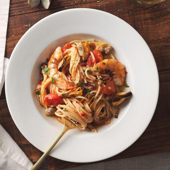 """<p>A citrusy, sharp dry white would offer a welcome contrast to the briny mussels and clams. Look for an Italian Pinot Grigio.</p><p><a href=""""https://www.foodandwine.com/recipes/spaghetti-with-mussels-clams-and-shrimp"""">GO TO RECIPE</a></p>"""