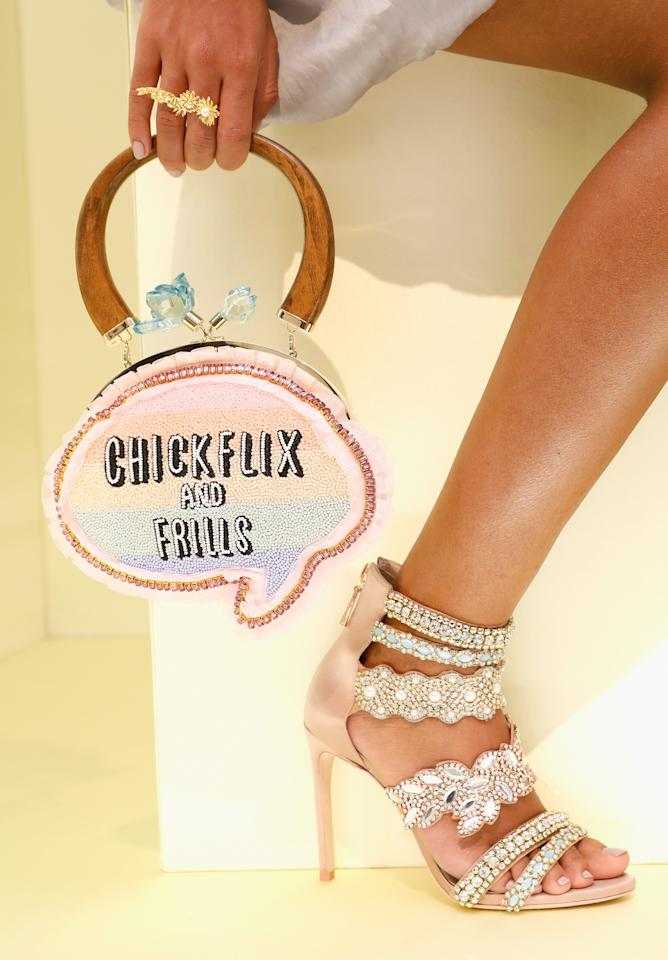<p>Yep, we all had a good chuckle at this speech bubble bag.<em> [Photo: Rex]</em> </p>