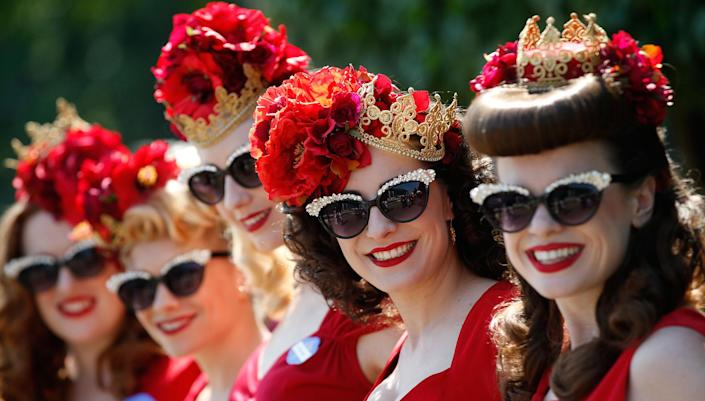 <p>Anna Gilthorpe, right with Khiley Williams, Meg Gallagher, Katy Heavens, and Lisa Millar pose for photographers on the first day of the Royal Ascot horse race meeting in Ascot, England, Tuesday, June 20, 2017. (AP Photo/Alastair Grant) </p>