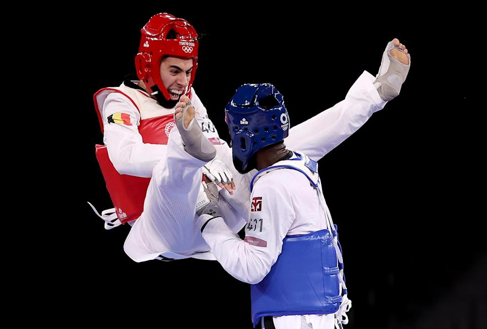<p>Jaouad Achab (left) of Belgium competes against Bernardo Pie of the Dominican Republic in Taekwondo on July 25.</p>