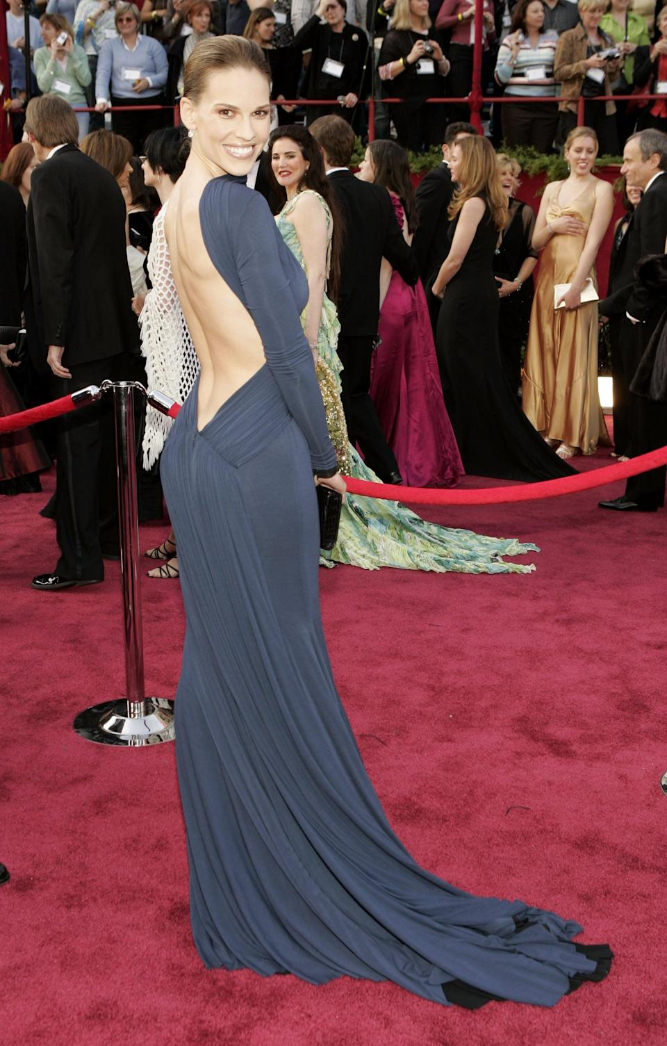 <p>This backless navy blue Guy Laroche dress gave Hilary an element of polish and elegance.</p>